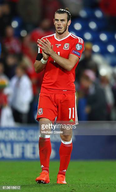 Gareth Bale of Wales applauds the fans after the FIFA 2018 World Cup Qualifier Group D match between Wales and Georgia at Cardiff City Stadium on...