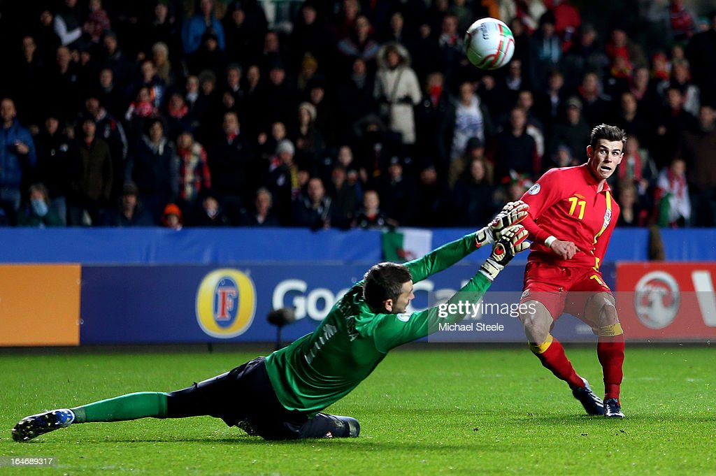 Gareth Bale of Wales beats goalkeeper Stipe Pletikosa of Croatia only for his shot to go wide during the FIFA 2014 World Cup qualifier between Wales...