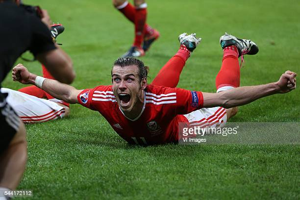 Gareth Bale of Wales celebrate during the UEFA EURO 2016 quarter final match between Wales and Belgium on July 2 2016 at the Stade Pierre Mauroy in...