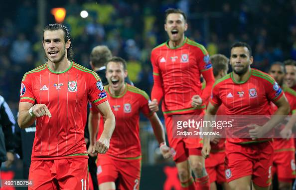Gareth Bale of Wales celebrate with the team mates Chris Gunter Aaron Ramsey and Hal RobsonKanu after the Euro 2016 qualifying football match between...