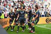 Gareth Bale of Wales celebrates after scoring the first goal with his team mates during the UEFA EURO 2016 Group B match between England and Wales at...