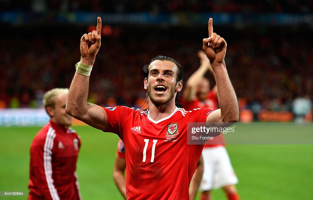 <a gi-track='captionPersonalityLinkClicked' href=/galleries/search?phrase=Gareth+Bale&family=editorial&specificpeople=609290 ng-click='$event.stopPropagation()'>Gareth Bale</a> of Wales celebrates his team's 3-1 win after the UEFA EURO 2016 quarter final match between Wales and Belgium at Stade Pierre-Mauroy on July 1, 2016 in Lille, France.
