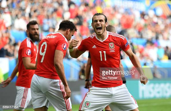 Gareth Bale of Wales celebrates his team's second goal scored by Hal RobsonKanu during the UEFA EURO 2016 Group B match between Wales and Slovakia at...