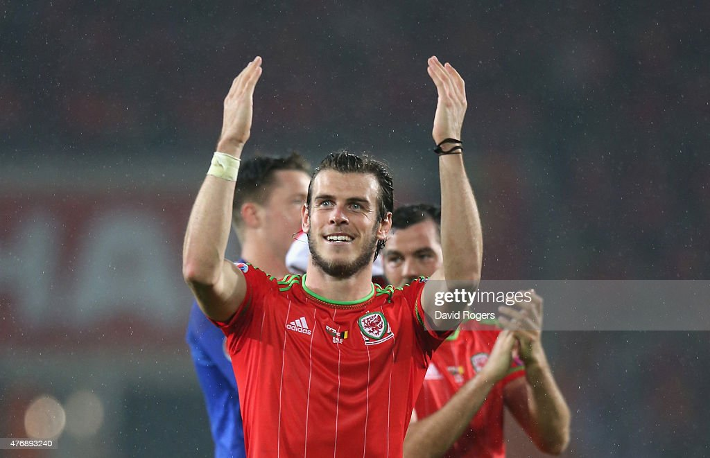 Gareth Bale of Wales celebrates his teams victory during the UEFA EURO 2016 qualifying match between Wales and Belgium at the Cardiff City Stadium on...