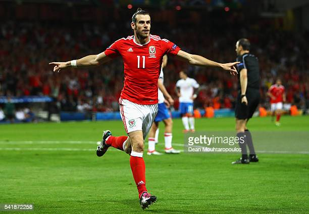 Gareth Bale of Wales celebrates scoring his team's third goal during the UEFA EURO 2016 Group B match between Russia and Wales at Stadium Municipal...