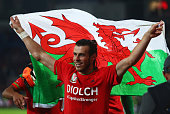 Gareth Bale of Wales celebrates victory after the UEFA EURO 2016 qualifying Group B match between Wales and Andorra at Cardiff City Stadium on...