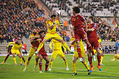 Gareth Bale of Wales clears the corner with a header during the Group B UEFA European Championship 2016 Qualifier match bewteen Belgium and Wales at...