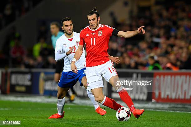 Gareth Bale of Wales competes with Ivan Obradovic of Serbia during the FIFA 2018 World Cup Qualifier between Wales and Serbia at Cardiff City Stadium...