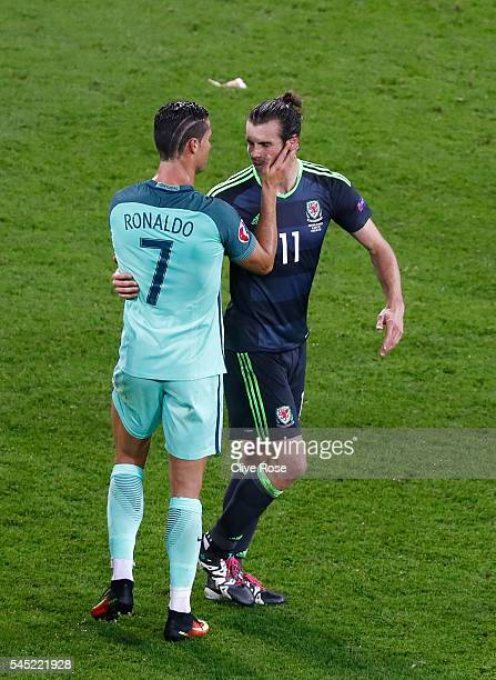 Gareth Bale of Wales embraces Cristiano Ronaldo of Portugal after the UEFA EURO 2016 semi final match between Portugal and Wales at Stade des...