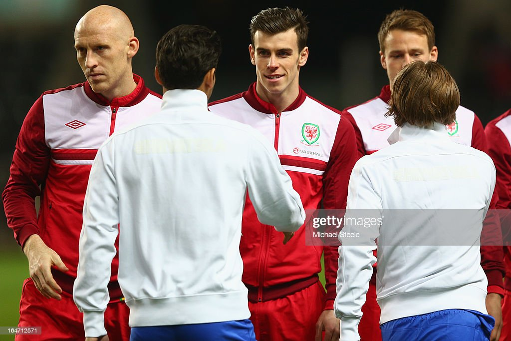 Gareth Bale (C) of Wales greets Eduardo (L) and Luka Modric (R) of Croatia after the national anthems ahead of the FIFA 2014 World Cup Group A Qualifier match between Wales and Croatia at the Liberty Stadium on March 26, 2013 in Swansea, Wales.