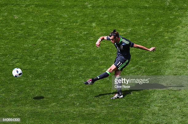 Gareth Bale of Wales hits a free kick during the UEFA EURO 2016 Group B match between England and Wales at Stade BollaertDelelis on June 16 2016 in...