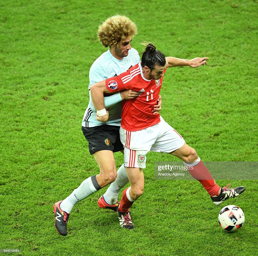 Gareth Bale (R) of Wales in action against Marouane Fellaini of Belgium during the UEFA Euro 2016 quarter final match between Wales and Belgium at Stade Pierre-Mauroy on July 1, 2016 in Lille, France.