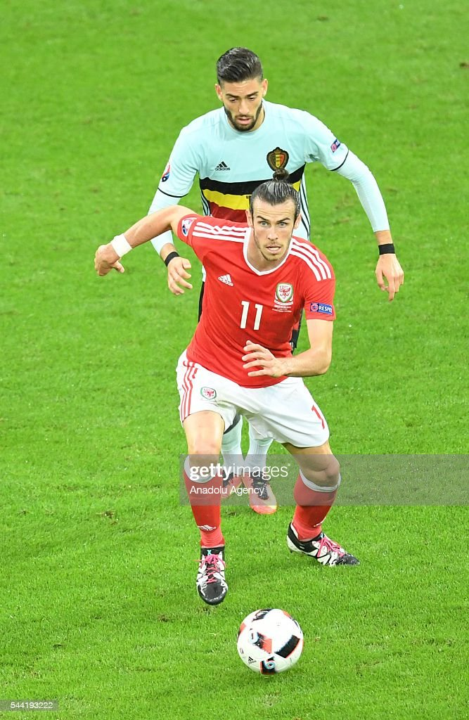 Gareth Bale (front) of Wales in action during the Euro 2016 quarter-final football match between Wales and Belgium at the Stadium Pierre Mauroy in Lille, France on July 1, 2016.