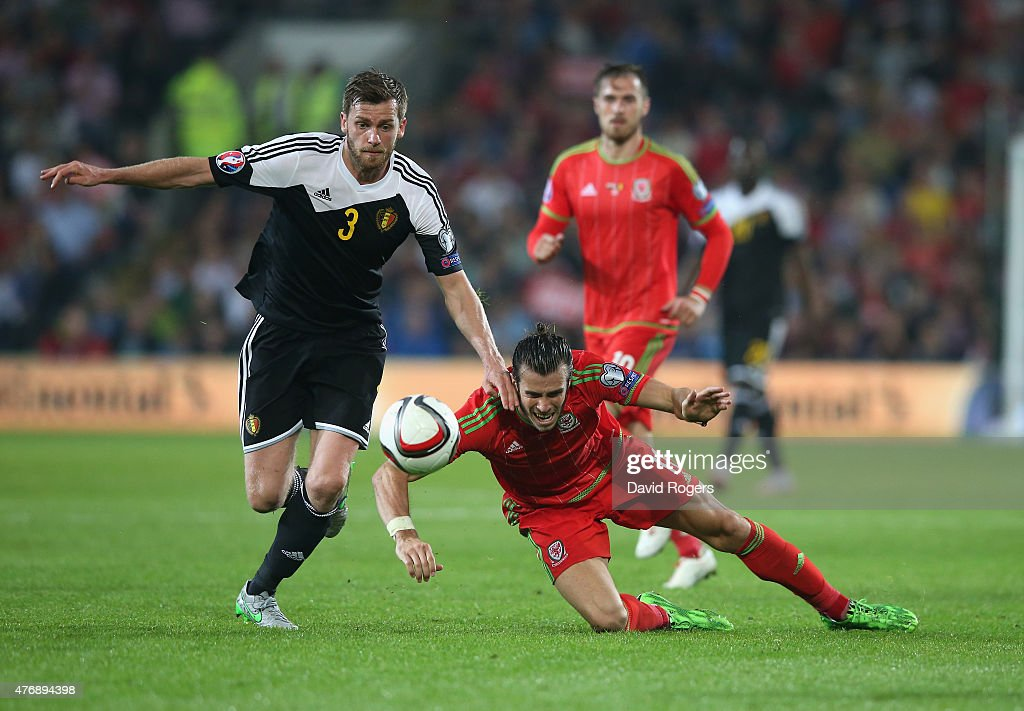 <a gi-track='captionPersonalityLinkClicked' href=/galleries/search?phrase=Gareth+Bale&family=editorial&specificpeople=609290 ng-click='$event.stopPropagation()'>Gareth Bale</a> (R) of Wales is broiught down by <a gi-track='captionPersonalityLinkClicked' href=/galleries/search?phrase=Nicolas+Lombaerts&family=editorial&specificpeople=4332055 ng-click='$event.stopPropagation()'>Nicolas Lombaerts</a> during the UEFA EURO 2016 qualifying match between Wales and Belgium at the Cardiff City Stadium on June 12, 2015 in Cardiff, United Kingdom.