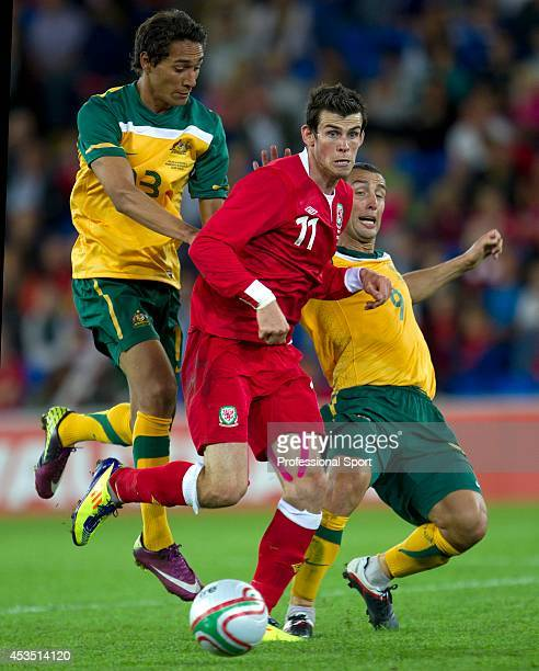 Gareth Bale of Wales is challenged by Scott McDonald and Robbie Kruse of Australia during the International Friendly match between Wales and...