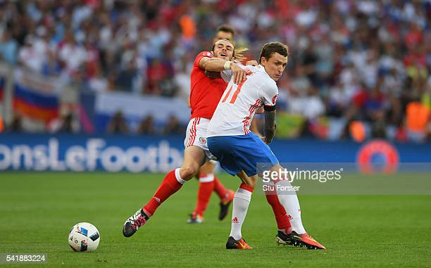 Gareth Bale of Wales is fouled by Pavel Mamaev of Russia during the UEFA EURO 2016 Group B match between Russia and Wales at Stadium Municipal on...