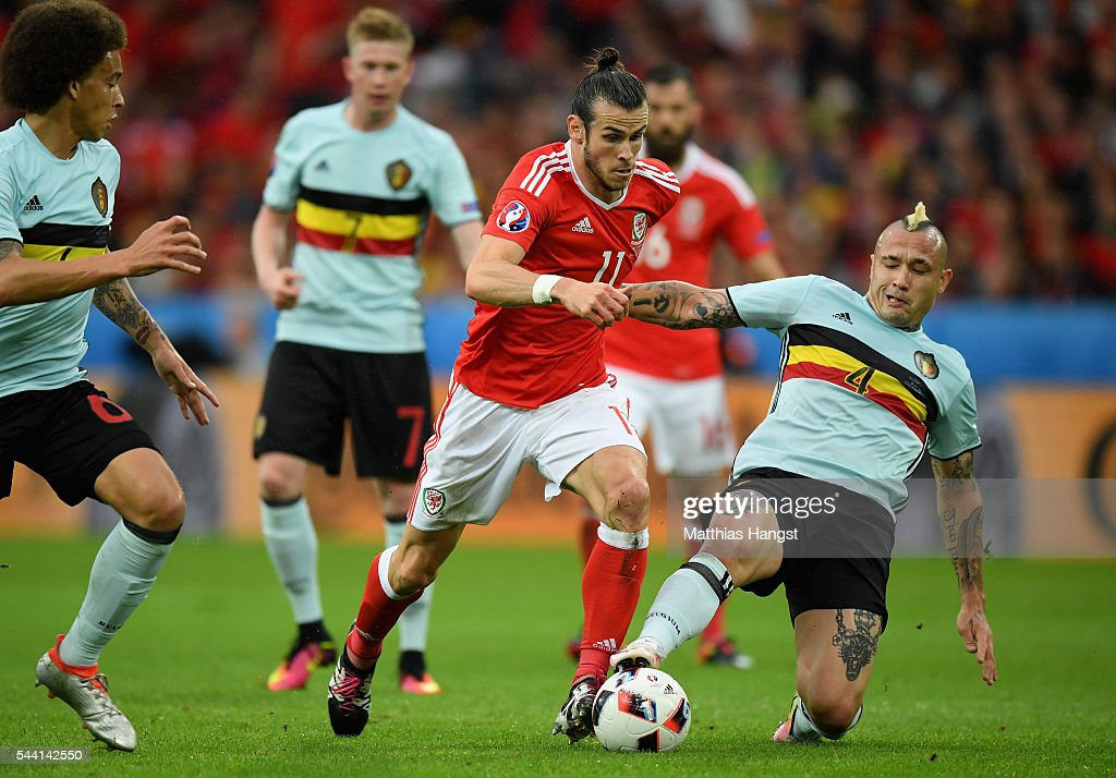 Gareth Bale of Wales is tackled by Radja Nainggolan of Belgium during the UEFA EURO 2016 quarter final match between Wales and Belgium at Stade Pierre-Mauroy on July 1, 2016 in Lille, France.