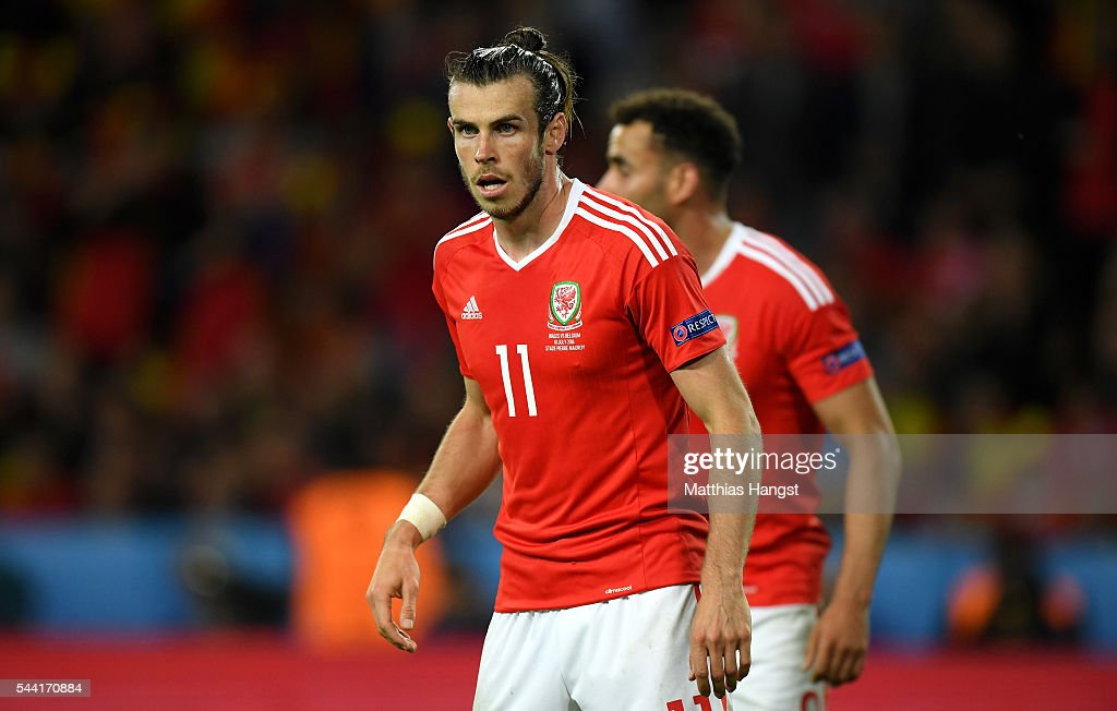 <a gi-track='captionPersonalityLinkClicked' href=/galleries/search?phrase=Gareth+Bale&family=editorial&specificpeople=609290 ng-click='$event.stopPropagation()'>Gareth Bale</a> of Wales looks on during the UEFA EURO 2016 quarter final match between Wales and Belgium at Stade Pierre-Mauroy on July 1, 2016 in Lille, France.