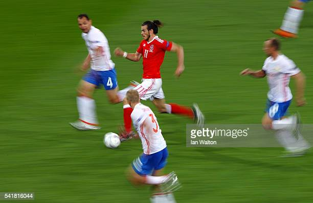 Gareth Bale of Wales runs with the ball in the Russa defense during the UEFA EURO 2016 Group B match between Russia and Wales at Stadium Municipal on...