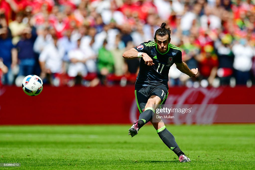 <a gi-track='captionPersonalityLinkClicked' href=/galleries/search?phrase=Gareth+Bale&family=editorial&specificpeople=609290 ng-click='$event.stopPropagation()'>Gareth Bale</a> of Wales scores his team's first goal during the UEFA EURO 2016 Group B match between England and Wales at Stade Bollaert-Delelis on June 16, 2016 in Lens, France.