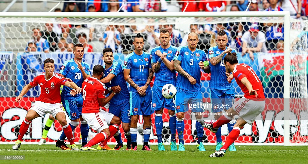 Gareth Bale of Wales scores his team's first goal from a free kick during the UEFA EURO 2016 Group B match between Wales and Slovakia at Stade Matmut...