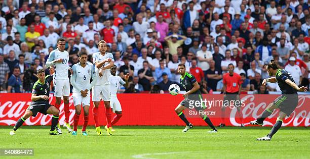 Gareth Bale of Wales scores his team's first goal from a free kick during the UEFA EURO 2016 Group B match between England and Wales at Stade...