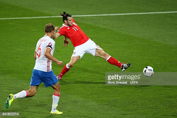 Gareth Bale of Wales scores his team's third goal during the UEFA EURO 2016 Group B match between Russia and Wales at Stadium Municipal on June 20...