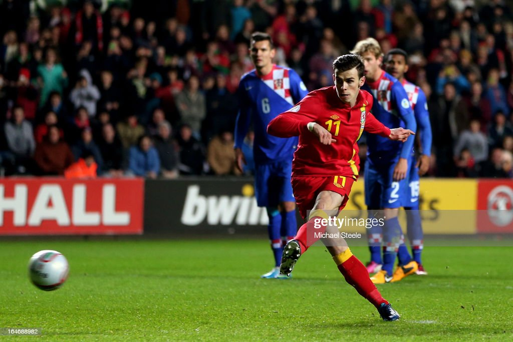 <a gi-track='captionPersonalityLinkClicked' href=/galleries/search?phrase=Gareth+Bale&family=editorial&specificpeople=609290 ng-click='$event.stopPropagation()'>Gareth Bale</a> of Wales scores the opening goal from the penalty spot during the FIFA 2014 World Cup qualifier between Wales and Croatia at The Liberty Stadium on March 26, 2013 in Swansea, Wales.