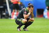 Gareth Bale of Wales shows his dejection after England's second goal during the UEFA EURO 2016 Group B match between England and Wales at Stade...