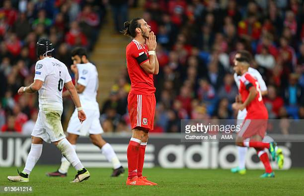 Gareth Bale of Wales stands dejected after missing a chance during the FIFA 2018 World Cup Qualifier between Wales and Georgia at Cardiff City...