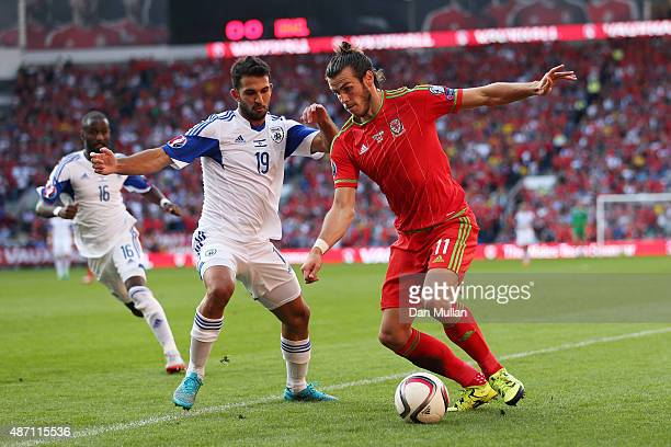 Gareth Bale of Wales takes on Orel Ogani of Israel during the UEFA EURO 2016 group B qualifying match between Wales and Israel at Cardiff City...