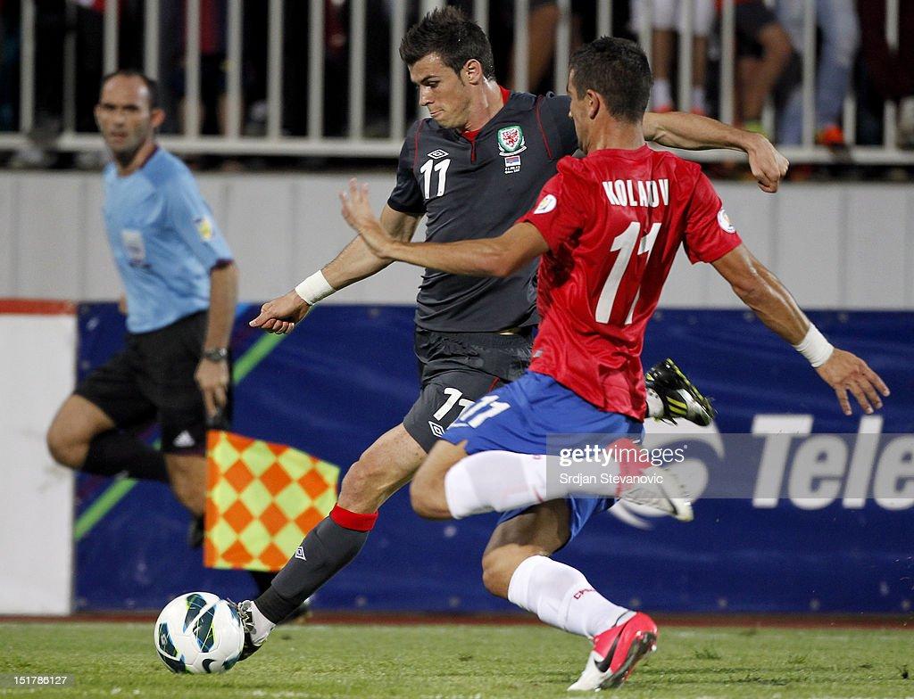 Gareth Bale (L) of Wales try to shoot near Aleksandar Kolarov (R) of Serbia during the FIFA 2014 World Cup Qualifier at stadium Karadjordje Park between Serbia and Wales on September 11, 2012 in Novi Sad, Serbia
