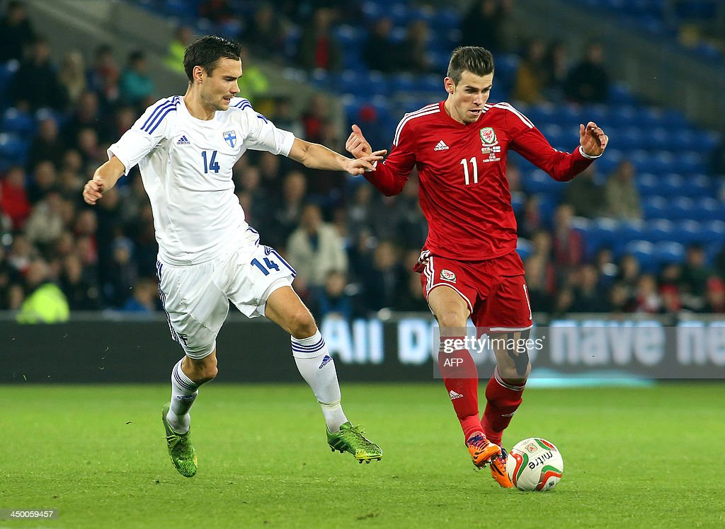 Gareth Bale (R) of Wales vies for the ball with Tim Sparv (L) of Finland during the international friendly football match between Wales and Finland at Cardiff City Stadium in Cardiff, south Wales on November 16, 2013. The match ended 1-1.