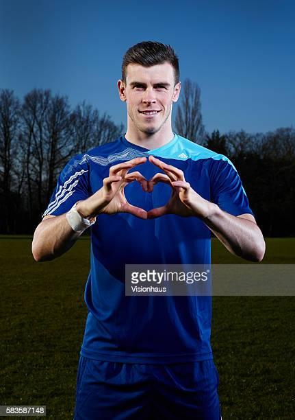 Gareth Bale shows his celebratory heart sign at the Metropolitan Police Sports Club Chigwell Essex Photo Visionhaus/Gary Prior