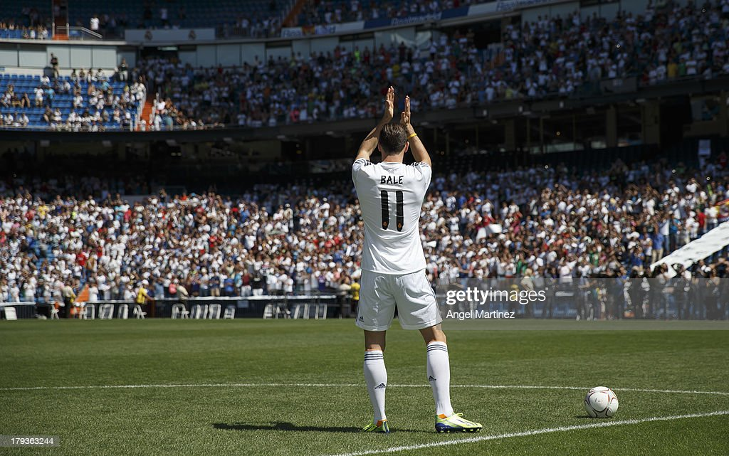 Gareth Bale waves to fans during his official presentation as a new Real Madrid player at Estadio Santiago Bernabeu on September 2, 2013 in Madrid, Spain.