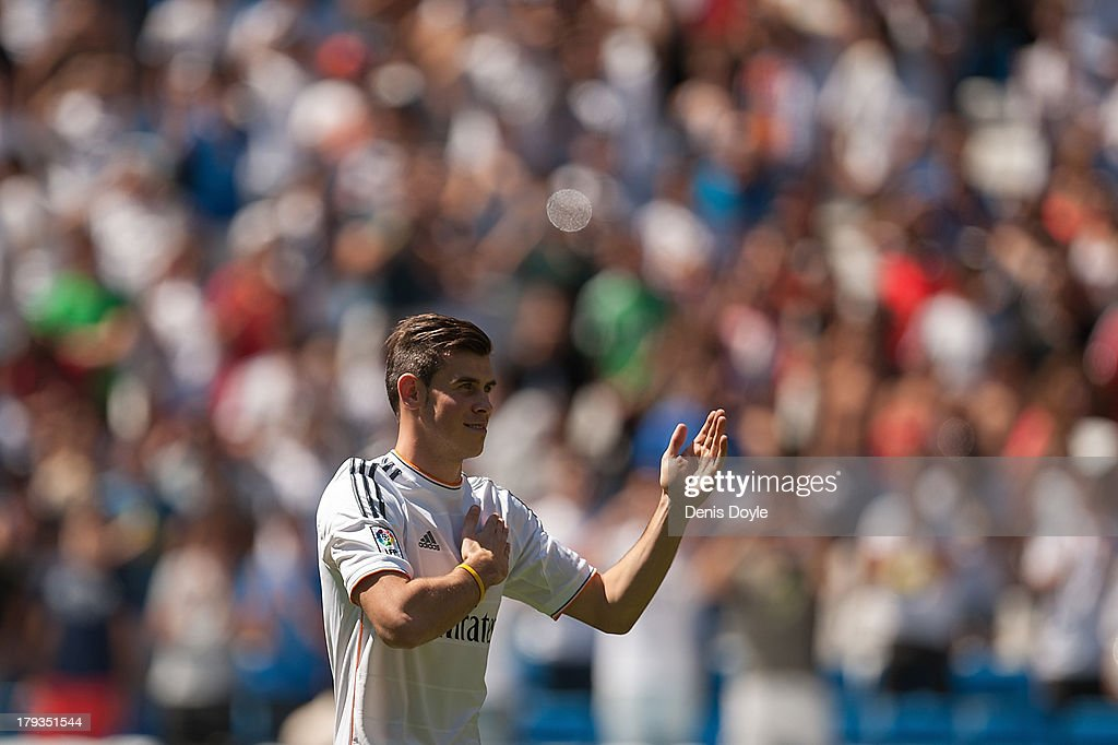 Gareth Bale waves to fans in his new Real Madrid shirt during his official unveiling at estadio Santiago Bernabeu on September 2, 2013 in Madrid, Spain.