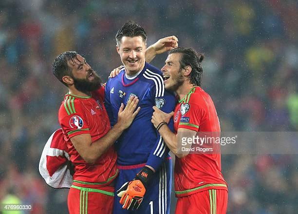 Gareth Bale who scored the winning for Wales celebrates with team mates Wayne Hennessey and Joe Ledley after their victory during the UEFA EURO 2016...