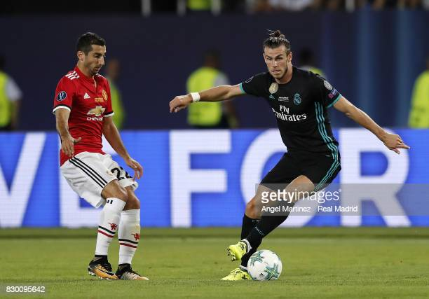 Gareth Balea of Real Madrid is challenged by Henrikh Mkhitaryan of Manchester United during the UEFA Super Cup match between Real Madrid and...