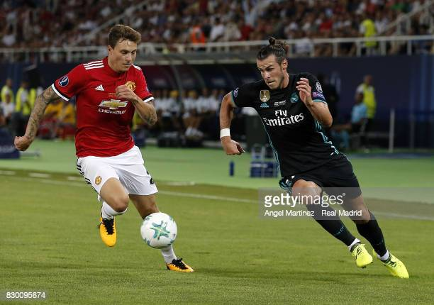 Gareth Balea of Real Madrid is chased by Victor Lindelof of Manchester United during the UEFA Super Cup match between Real Madrid and Manchester...
