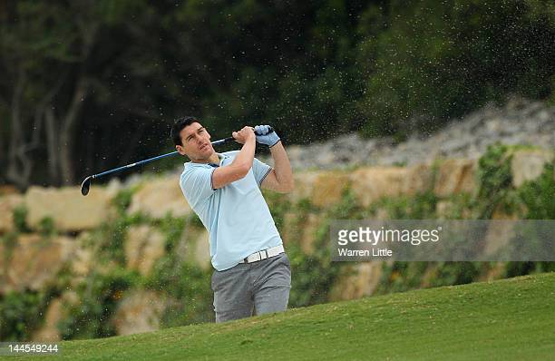 Gareth Barry footballer for Manchester City plays out of a bunker during the Pro Am for the Volvo World Match Play Championship at Finca Cortesin on...
