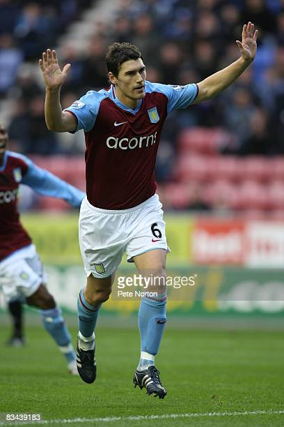 Gareth Barry of Aston Villa celebrates after scoring his sides first goal from the penalty spot during the FA Barclays Premier League match between...