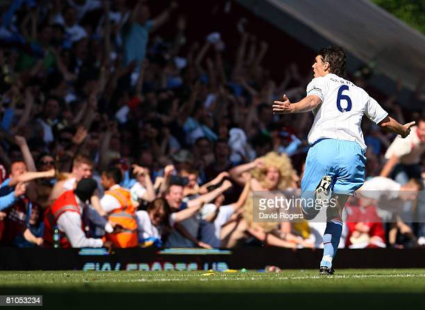 Gareth Barry of Aston Villa celebrates scoring the second goal for Aston Villa during the Barclays Premier League match between West Ham United and...