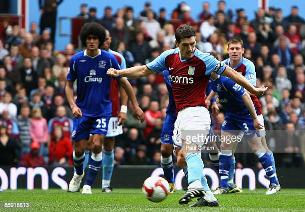 Gareth Barry of Aston Villa scores a penalty to level the game 33 during the Barclays Premier League match between Aston Villa and Everton at Villa...
