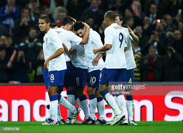 Gareth Barry of England is congratulated by team mates after his header was deflected off the head of Daniel Majstorovic of Sweden to score their...