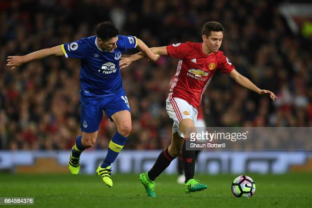 Gareth Barry of Everton and Ander Herrera of Manchester United battle for possession during the Premier League match between Manchester United and...