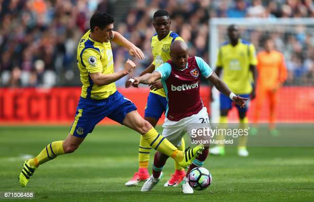 Gareth Barry of Everton and Andre Ayew of West Ham United in action during the Premier League match between West Ham United and Everton at the London...