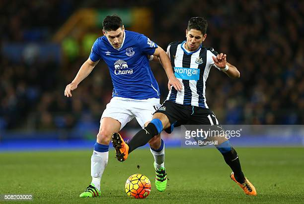 Gareth Barry of Everton and Ayoze Perez of Newcastle United battle for the ball during the Barclays Premier League match between Everton and...