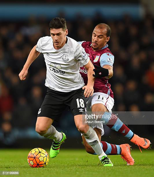 Gareth Barry of Everton and Gabriel Agbonlahor of Aston Villa compete for the ball during the Barclays Premier League match between Aston Villa and...
