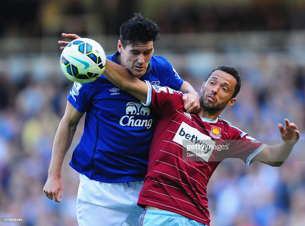 <a gi-track='captionPersonalityLinkClicked' href=/galleries/search?phrase=Gareth+Barry&family=editorial&specificpeople=209123 ng-click='$event.stopPropagation()'>Gareth Barry</a> of Everton and Nene of West Ham compete for the ball during the Barclays Premier League match between West Ham United and Everton at Boleyn Ground on May 16, 2015 in London, England.