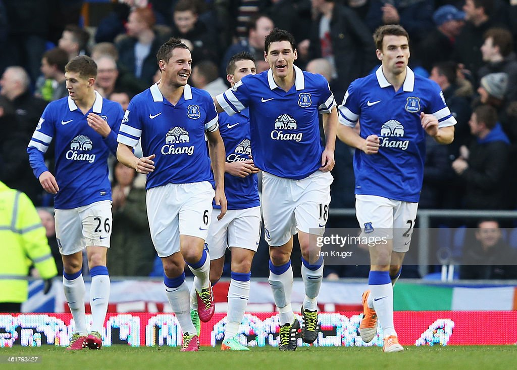 <a gi-track='captionPersonalityLinkClicked' href=/galleries/search?phrase=Gareth+Barry&family=editorial&specificpeople=209123 ng-click='$event.stopPropagation()'>Gareth Barry</a> of Everton celebrates his goal with <a gi-track='captionPersonalityLinkClicked' href=/galleries/search?phrase=Phil+Jagielka&family=editorial&specificpeople=682518 ng-click='$event.stopPropagation()'>Phil Jagielka</a> during the Barclays Premier League match between Everton and Norwich City at Goodison Park on January 11, 2014 in Liverpool, England.